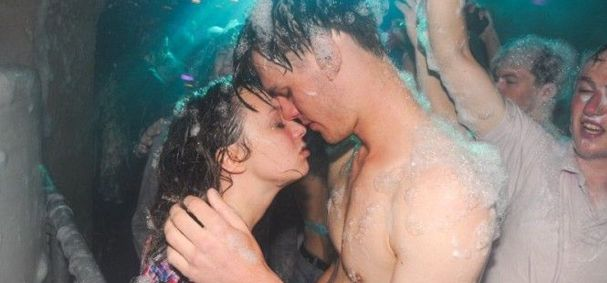 girl and guy head to head at foam party